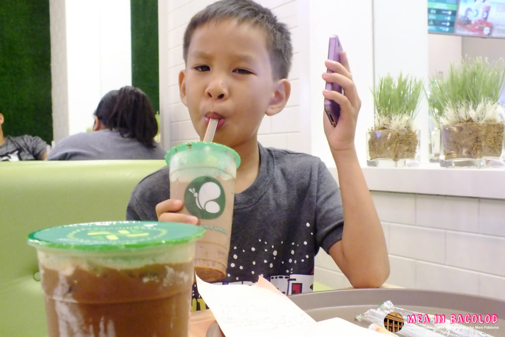 My Son Loving the Milk Tea Drinks at Serenitea